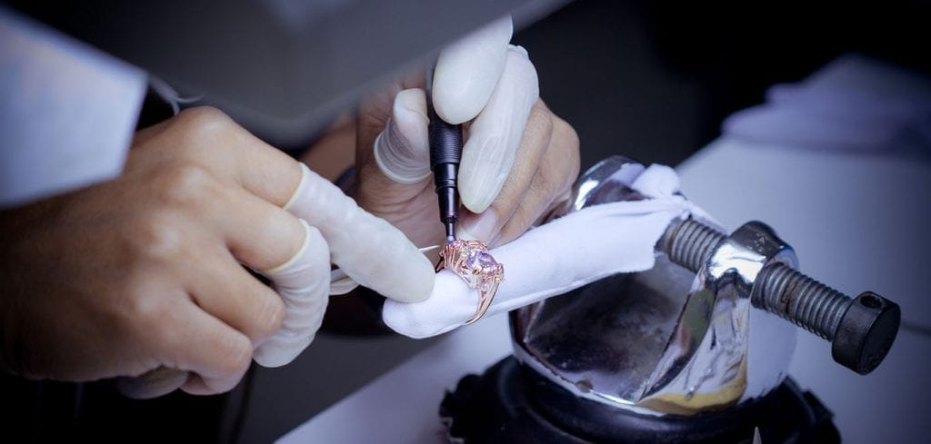 Diamond ring being inspected