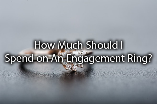 "An engagement ring with the words, ""how much should I spend on an engagement ring?"""