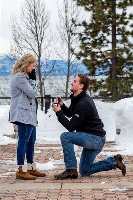 a man on one knee proposing to a woman