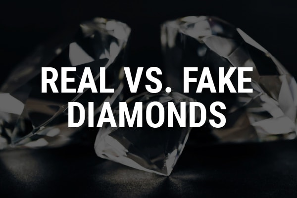 """Beautiful diamonds on a black background with the words, """"Real Vs. Fake Diamonds."""""""