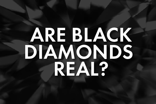 """A closeup of a black diamond with the words, """"are black diamonds real?"""""""